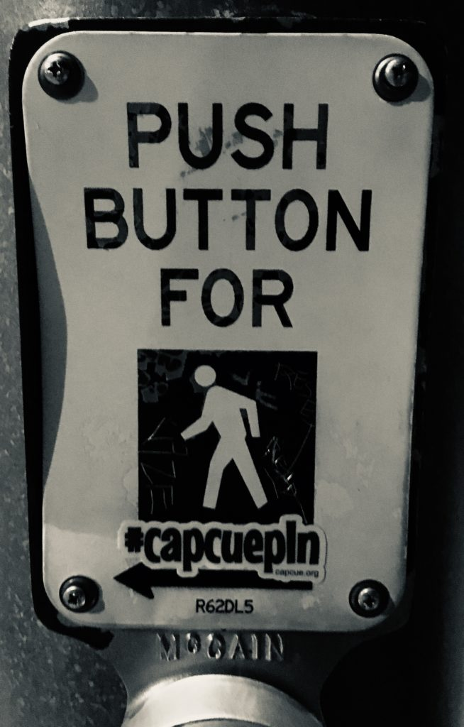 Crosswalk sign with CapCUE sticker